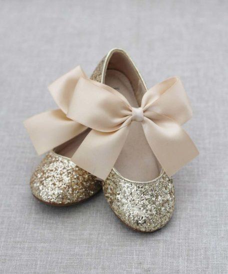 Gouden feestschoentjes met glitters voor meisjes met een strik goud schoenen