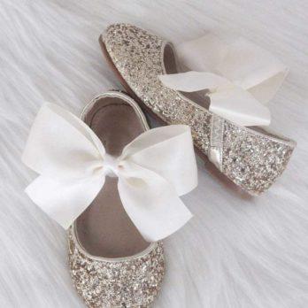 Gouden glitter schoenen voor meisjes met ivoren satijnen strik