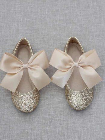 Gouden glitter schoenen voor meisjes met gouden satijnen strik