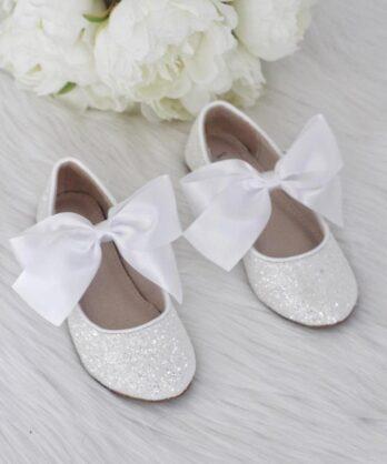 Witte glitter schoenen voor meisjes met satijnen strik