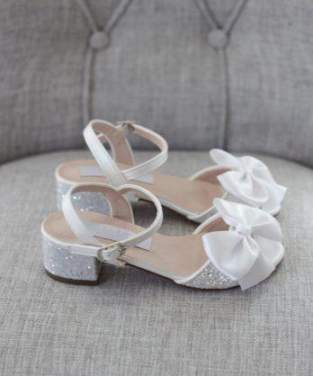 Glitter kinderschoenen met hakje en strik – Wit