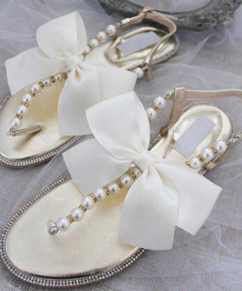 Slippers voor dames met parels en strik – Goud